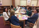 Teachers meeting and collaborating